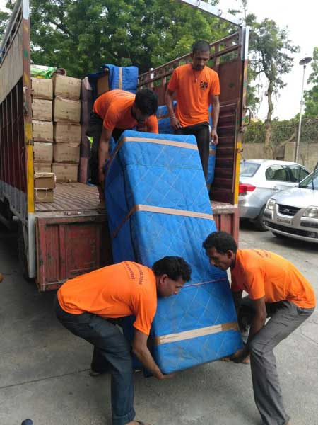 Packers and Movers Team While Loading